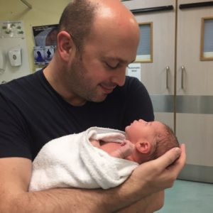dad holding new baby