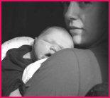 newbirn baby asleep on mum's shoulder