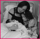 New baby with older sister and mum